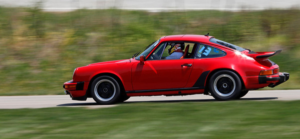 Matt Napieralski drove his Porsche 911 to 2nd in Class E and 5th overall with a best time of 45.834.  A record 32 drivers competed in the opening round of the Michiana BMW CCA autocross season at the Tire Rack on May 19, 2012. (Bradley S. Pines / CONTACT: OneTrackMind.brad@gmail.com)