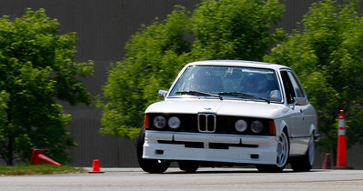 Chris Itterly drove his Class B classic white 1979 e21 323i to first place in B/C/D and 7th overall with a fastest time of 47.184 (46.245). A record 32 drivers competed in the opening round of the Michiana BMW CCA autocross season at the Tire Rack on May 19, 2012. (Bradley S. Pines / CONTACT: OneTrackMind.brad@gmail.com)