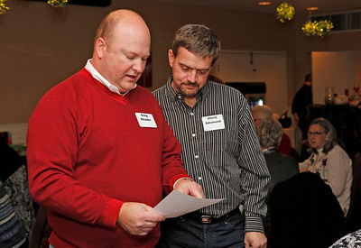 Greg Strader and Steve Adsmond, who helped organize the fete, confer.