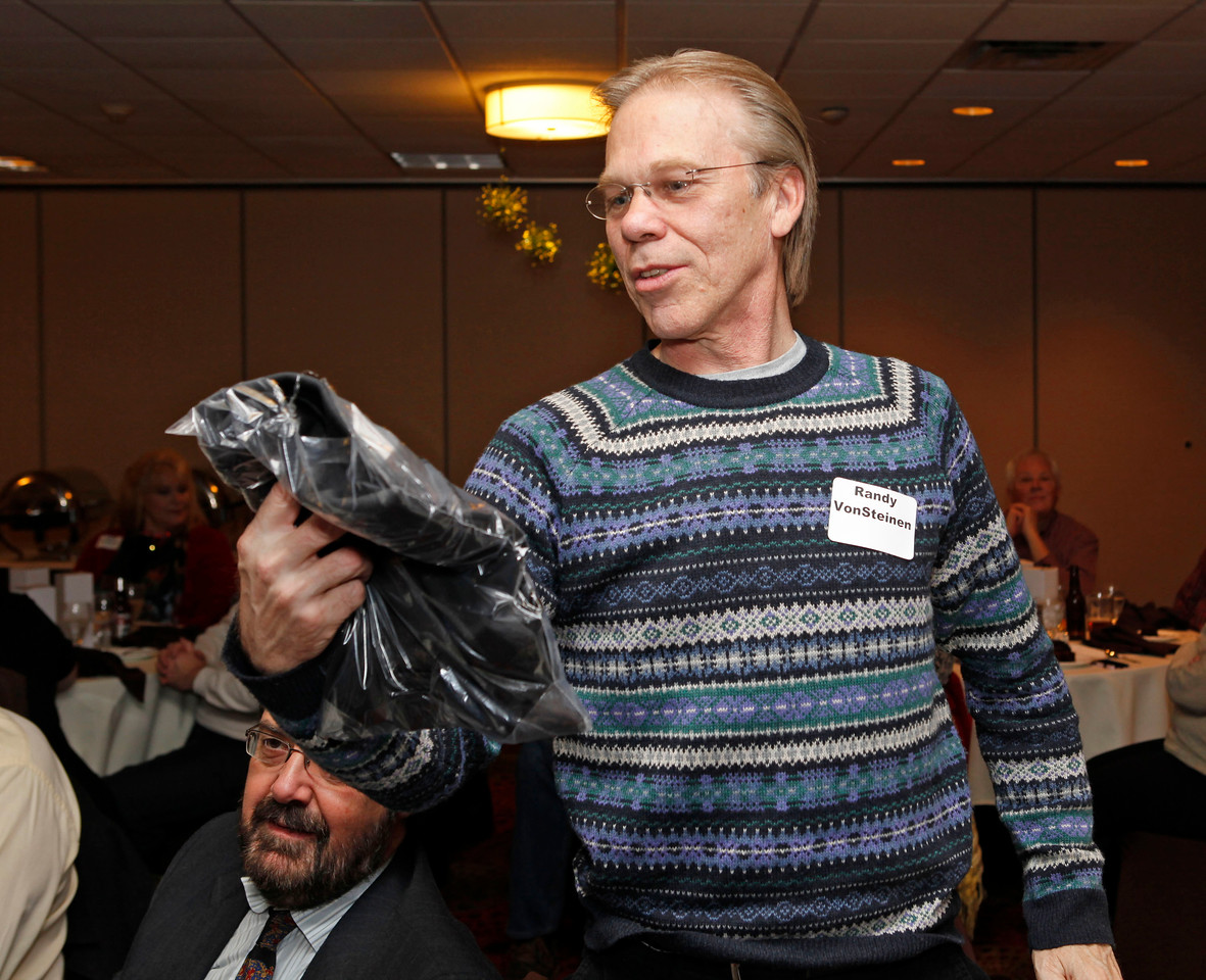 Randy von Steinen admires his new shirt. Randy was one of the chapter's founding members.