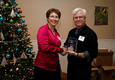 Michiana Treasurer Eve Dolenski presents Brad Pines with the Outstanding Member of the Year Award in recognition of his work as BimmerBulletin editor.