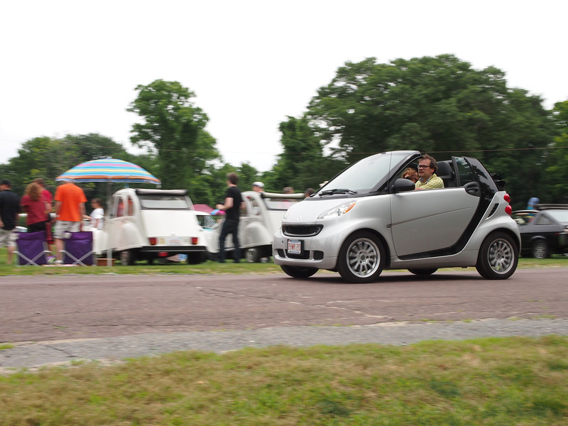 Smart Car giving rides at the Microcar and Minicar show at Larz Andersen Auto Museum in Brookline, MA on July 15, 2012