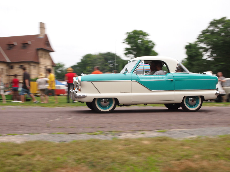 1960 Nash Metropolitan 1500 giving rides at the Microcar and Minicar show at Larz Andersen Auto Museum in Brookline, MA on July 15, 2012