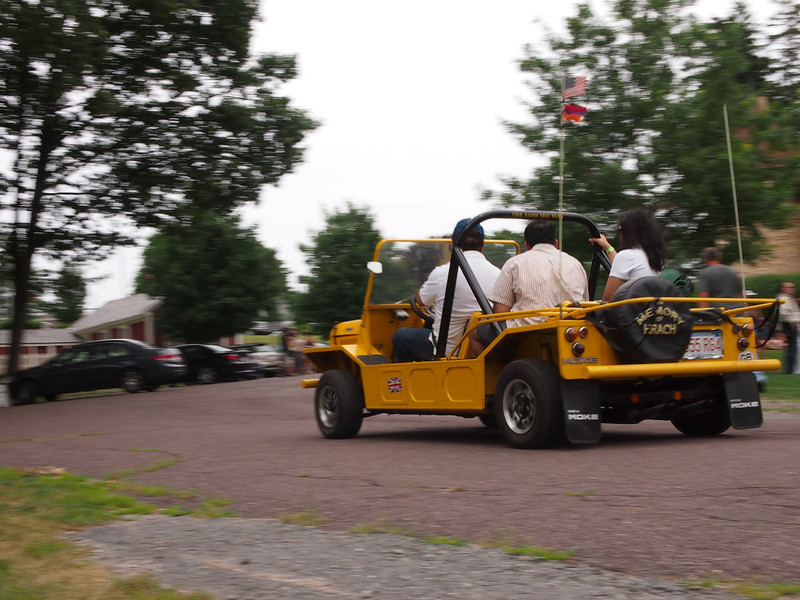 Mini Moke giving rides at the Microcar and Minicar show at Larz Andersen Auto Museum in Brookline, MA on July 15, 2012