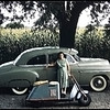 My first car, 1949 Chevy, my Cushman motor scooter and my mon. Taken in 1959 when I was 16. In Ohio. Scanned from a blurry slide.