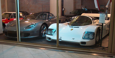 Carrera GT and Porsche 956 at dealership in Monaco