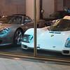Carrera GT and Porsche 956 at dealership in Monaco