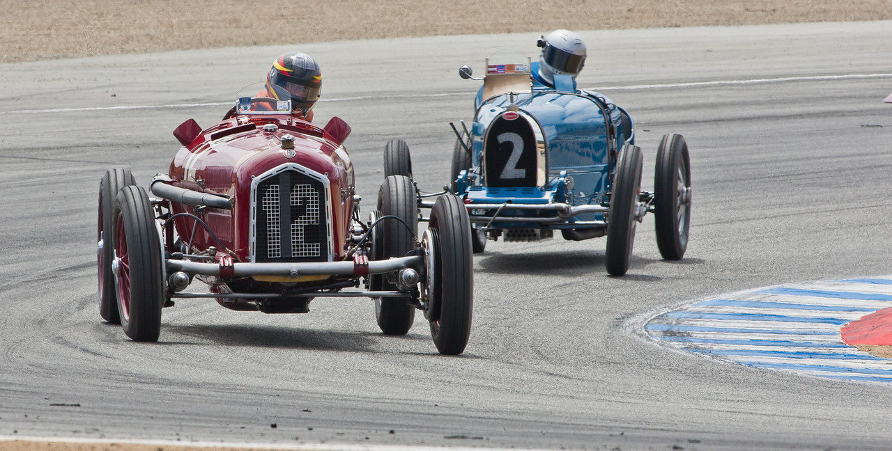 Jon Shirley's 1934 Alfa P3 leads Bill Lyons 1927 Bugatti 35B out of hairpin