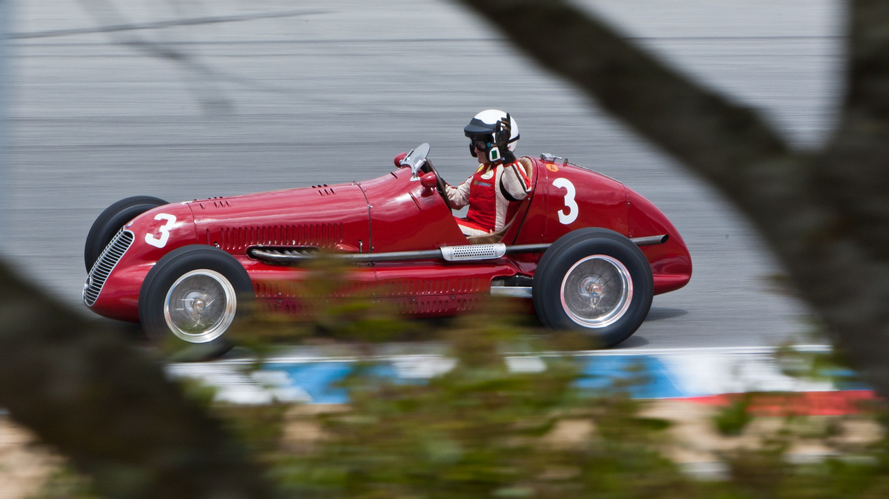 Paddins Dowling waves in his 1939 Maserati 4CL