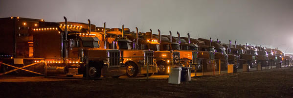 The morning of Pebble Beach - transporters unload at dawn