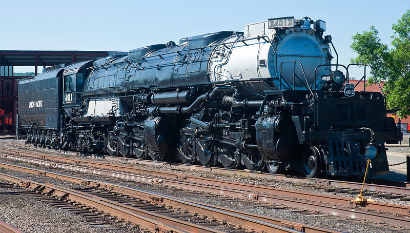 "The apotheosis of the Age of Steam, the 4-8-8-4 (refers to the wheel sets -- two two-wheel steering trucks, followed by two sets of four-wheeled drivers, with two two-wheel trailers below the cab) class 4000 ""Big Boys"" weighed 1,189,500 pounds loaded, occupied almost 132 feet of track and reached speeds of up to 80 miles an hour.<br /> <br /> Union Pacific bought 25 of them to haul heavy big troop and freight trains over the Wasatch Range -- the lowest, though among the steepest, of the Rocky Mountains -- during WWII.<br /> <br /> This one, built at ALCO in 1941, is retired in the yard at Steamtown  <a href=""http://www.nps.gov/stea/index.htm"">http://www.nps.gov/stea/index.htm</a>), a National Park Service Historic Site in Scranton, PA"