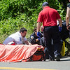 Emergency crews work on a 44-year-old male who was thrown from his motorcycle after colliding with a deer on Princeton Road in Fitchburg on Friday afternoon. The male driver was transported via Life Flight to UMass Memorial. SENTINEL & ENTERPRISE / Ashley Green