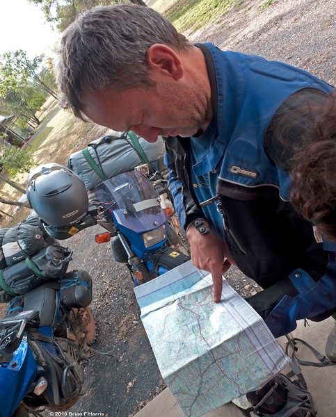 Steve Coote plots the course for today. They are mainly chasing dirt roads for their trip back home.