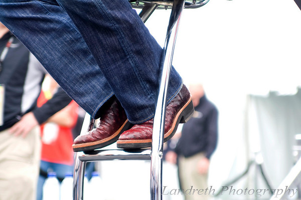 Since I was closer to stage floor level, I couldn't help but notice the footwear of each of the drivers.<br /> <br /> Clint Bowyer rockin the boots.