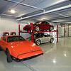 A lone Bricklin stands aside a pair of Porsches