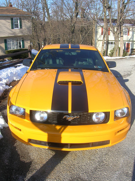 Grabber Orange 2007 Mustang GT with hood-to-trunk racing stripes