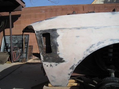 Cut out of the driver's side front fender.