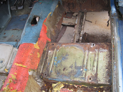 I cut out part of the passenger's side floor board. Had to put new metal in.