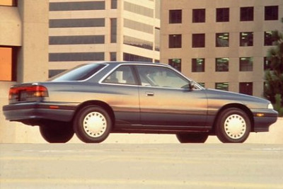 1989 Mazda MX-6.  I can't find any pics, although mine was just like this one but silver.  After wrecking the Corolla my senior year of high school, fixing it, and then proceeding to continually blow head gaskets, I purchased the MX-6.  It was a base model with the 5-speed.  It handled decently and was plenty quick for an 18 year old.