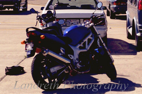 2000 Suzuki SV650. It is missed dearly.  I only had it a short while, as I sold it and my falling apart MX-6 to buy a Prelude.