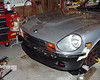 No more 50 pound bumpers.  Here are the 5 pound 240Z style bumpers from a 72 model.