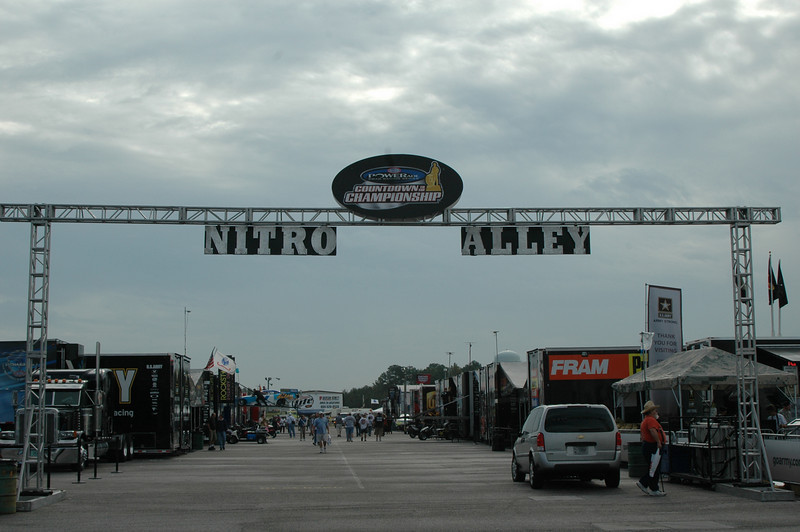"NITRO ALLEY <br /> This is the alley the top-fuelers (the very fastest dragsters, running on some evil concoction of 90 per cent nitromethan and 10 per cent methanol) rebuild and 'test fire' the engines before each race.<br /> This literally is, ""Life In The Fast Lane."""