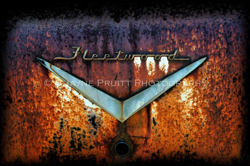 Rusty Old Fleetwood Cadillac Emblem'