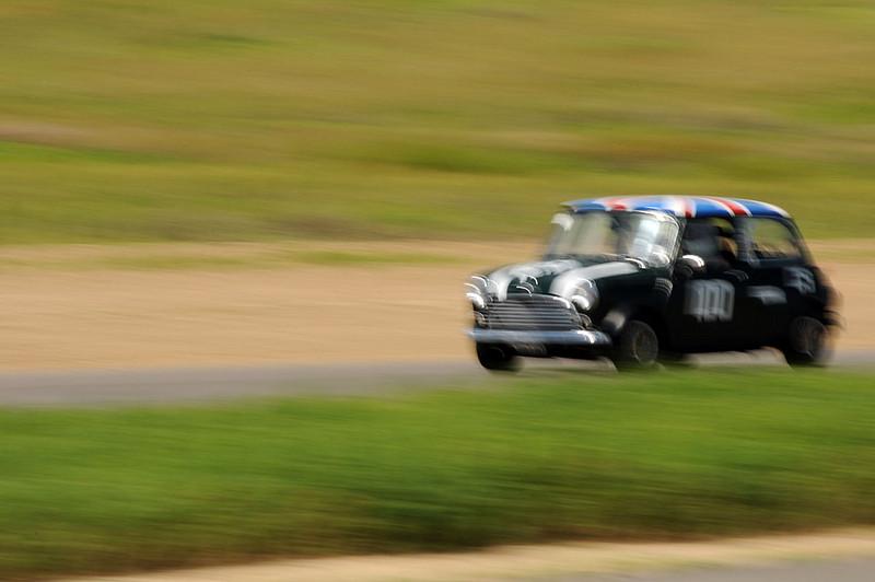 Dick in the #100 Classic Mini, fully race-ready.