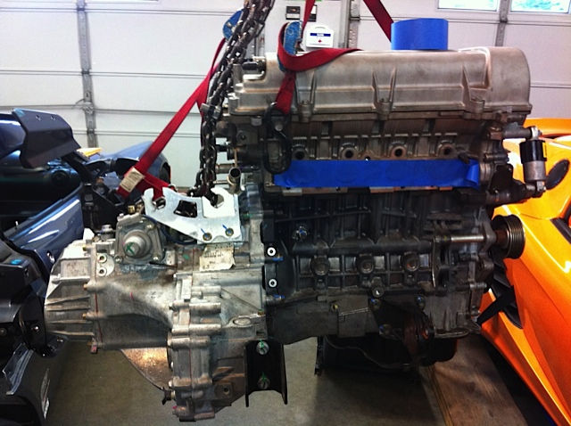 Replacement engine prepped, mated to original non-LSD trans awaiting install, you can't see it on the intake side in this pic...