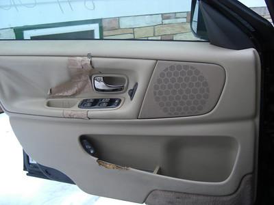 drivers side door panel a bit dog-chewed