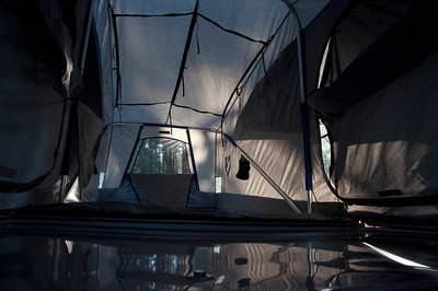 Inside the rooftop tent of a Jeep.