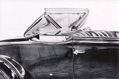 Packard brochure photo of taking down the roadster soft top.