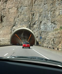 One of several tunnels of Glenwood Canyon. Passing through this narrow, deep canyon is the Colorado River, the D&RG railroad, I-70 (4 lanes) and a bike trail. No airplanes.