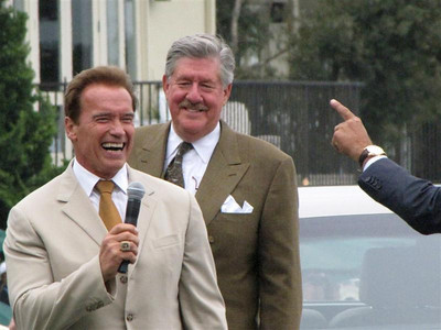 (d) Governor Arnold Schwarzenegger, Edward Hermann, and Jay Leno entertain the crowd.
