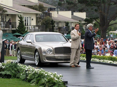 (d) Governor Arnold Schwarzenegger and Jay Leno entertain the crowd with the presentation of Bentley's newest mega-luxury sedan.