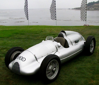 Auto Union Type D Grand Prix car. Built at the peak of German national pride in 1939, the Auto Union and Mercedes-Benz factory race teams battled each other for supremecy on Grand Prix circuits throughout Europe. During the War, the Auto Union cars were confiscated by the Soviet Army, dismantled and studied. However, this particular car, chassis #19, survived and was re-assembled using authentic Auto Union parts. It's powered by a 3.0-liter V12 with twin superchargers.