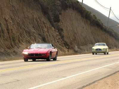 Maserati Ghibli Spyder, followed by a Ferrari 250GT that won its class at the Concours.