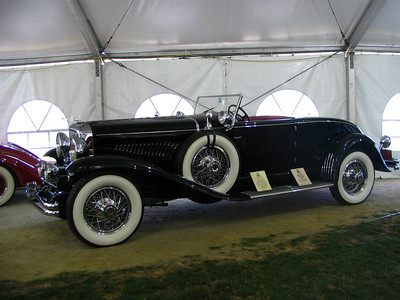 Duesenberg J Murphy Disappearing Top Roadster (1929). Previous owners include aviation pioneer Howard Hughes and entertainer Wayne Newton.