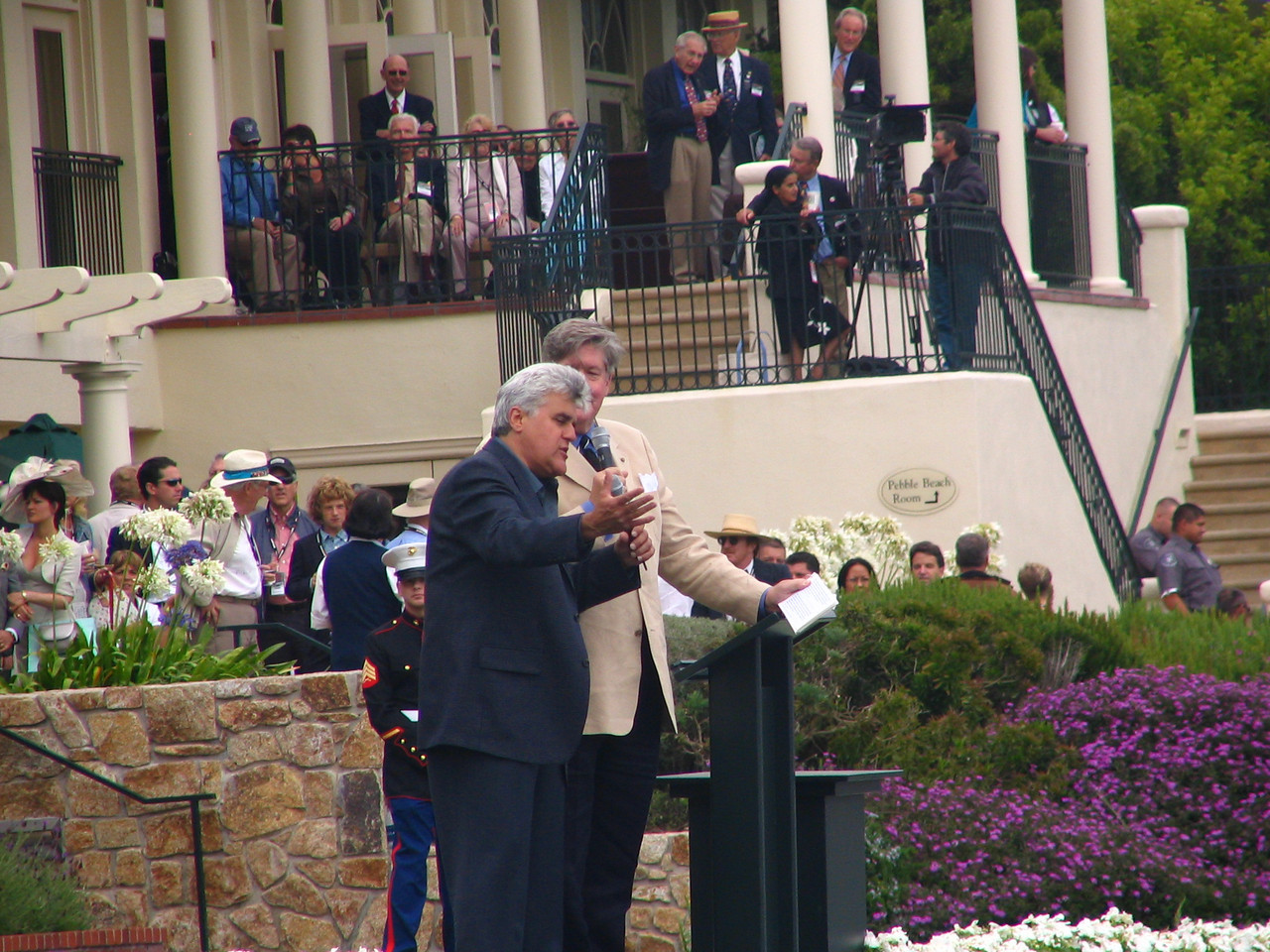Pebble Beach Concours -- Jay Leno warms up the crowd during raffle drawings