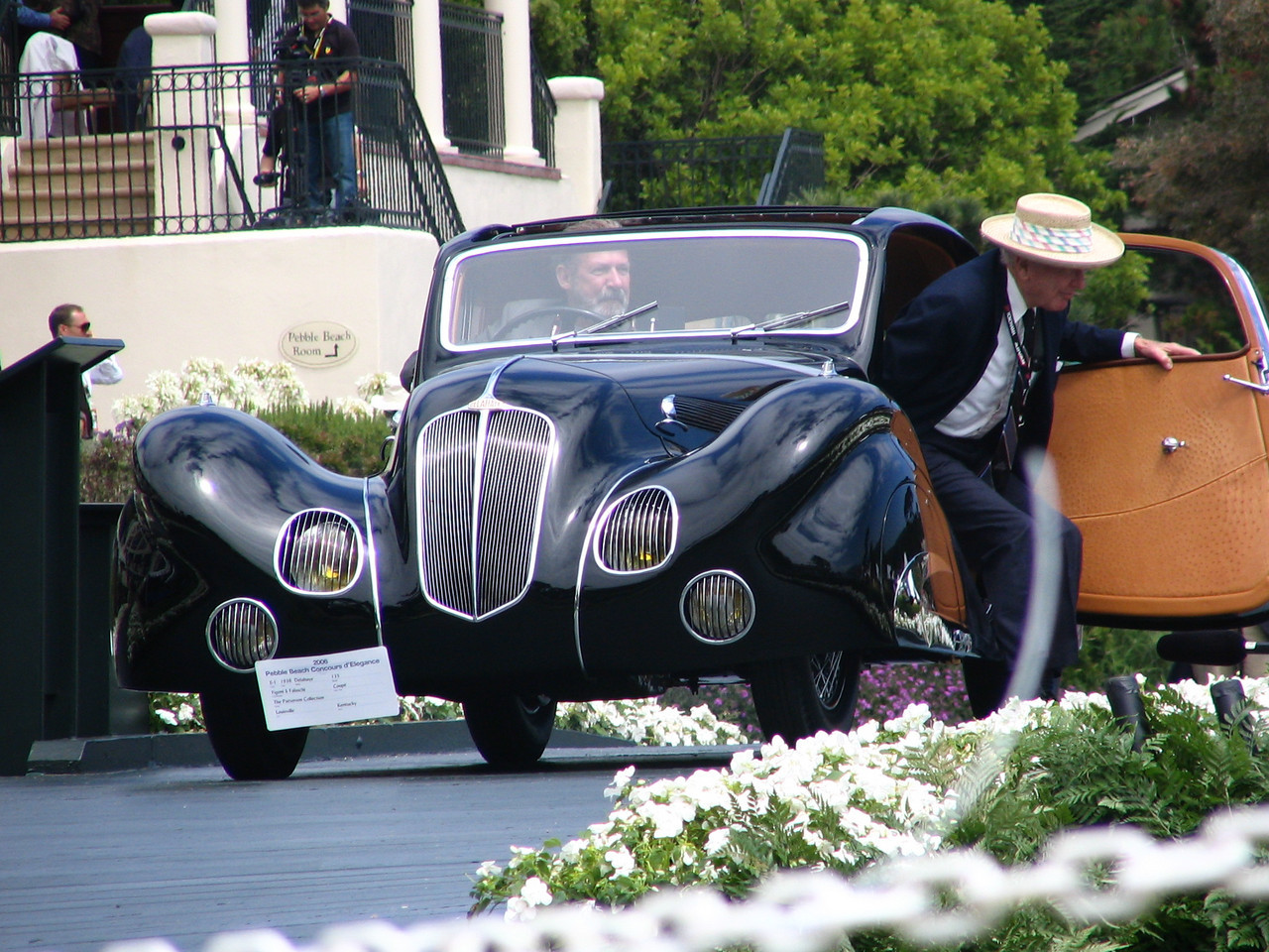 Pebble Beach Concours Chairman Emeritus Jules Heumann arriving