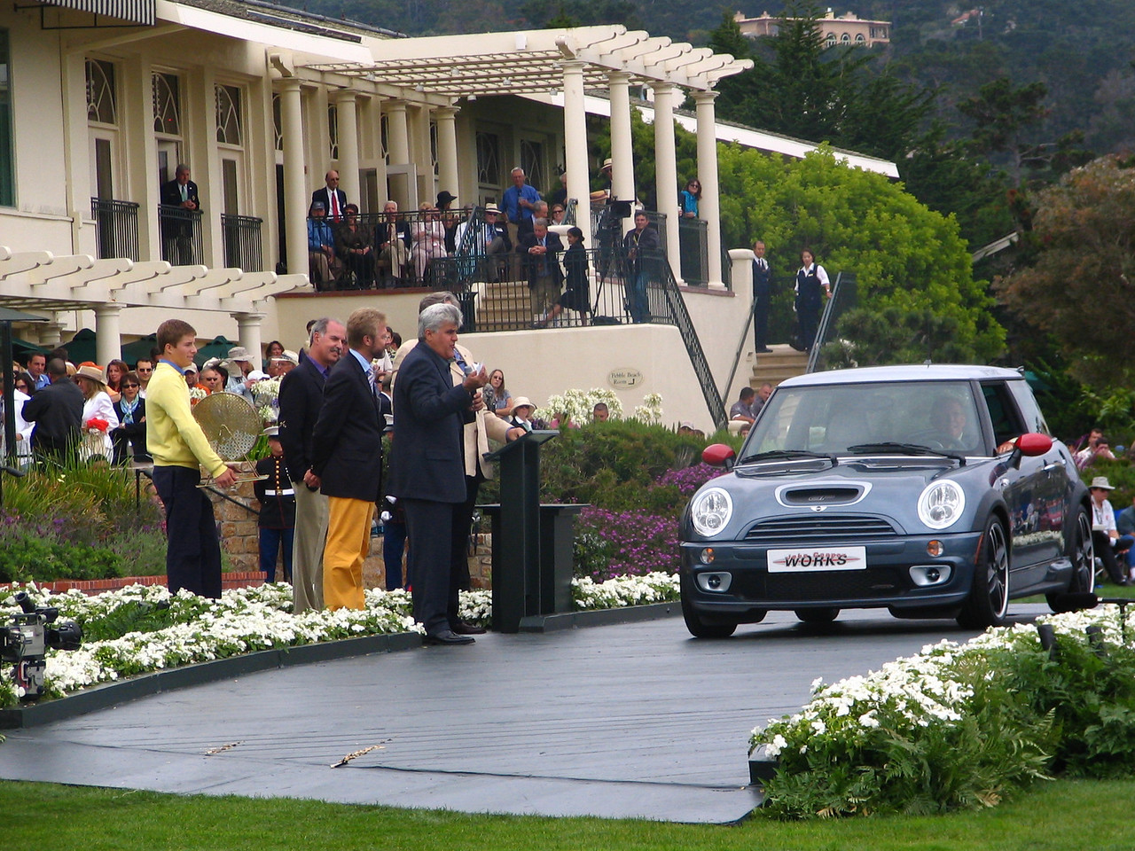 Pebble Beach Concours -- a Mini Cooper S GP Kit is given away by Chris Bangle of BMW (funny yellow pants) and Jay Leno