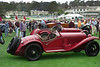 Alfas, probably an Isotta in the background. Viewing stands in far back.