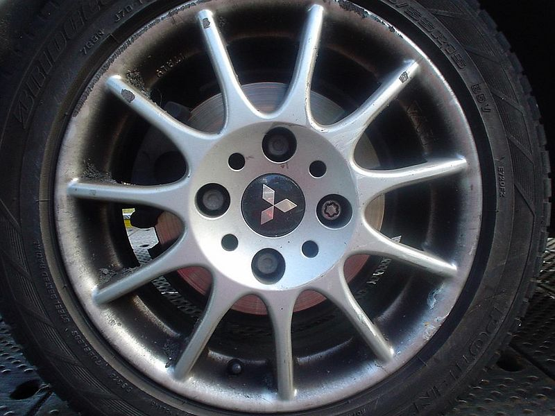 Right rear hubcap also badly damaged