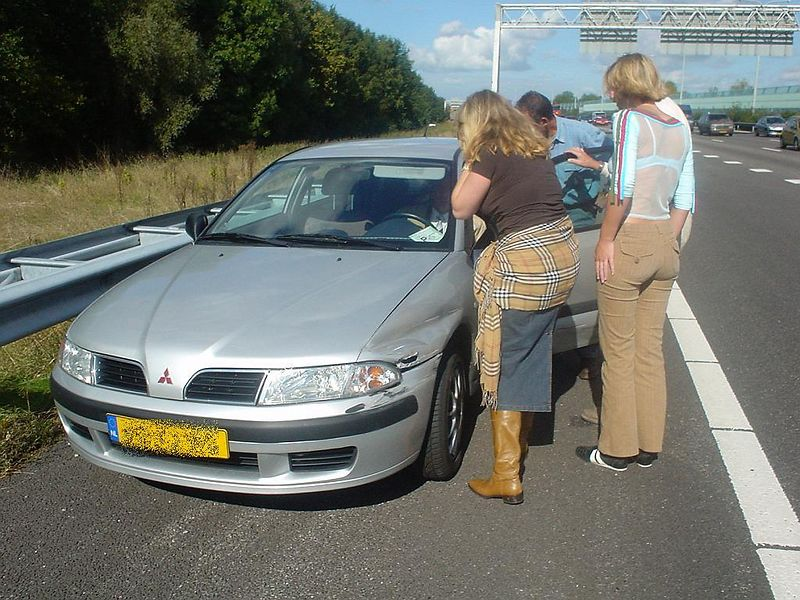 Checking with the car that caused us to hit him