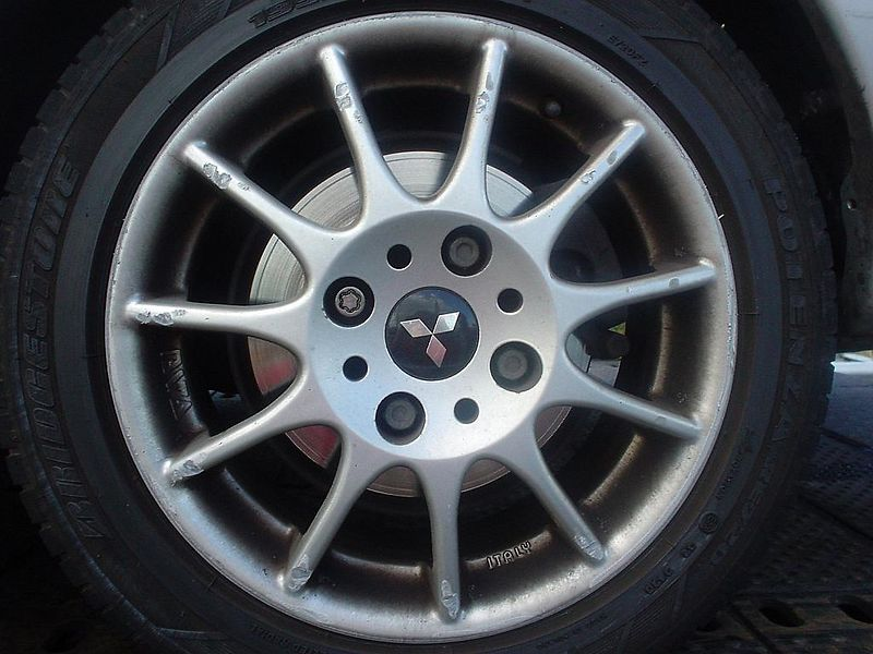 Hubcap (left rear) seriously damaged as well by something