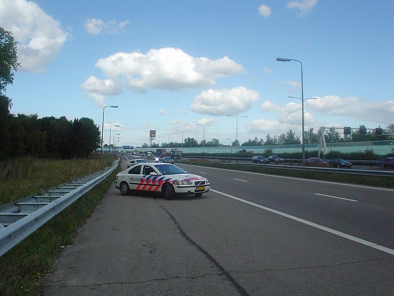 Police car marking and blocking the accident scene