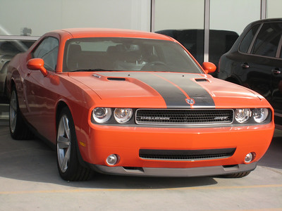 """If you've read September's 'AutoCar Middle East' you'll no doubt have seen the review of the new Dodge Challenger SRT8. To quote the article in the latest issue the SRT8 is """"....not due on sale here (the M.E.) until November/December."""" Well, nobody's told the boys at Al Awir about the car not being available until the end of the year because not only is there this drool-worthy SRT8 in bright orange out there for sale but there's a second one in black too, and the evidence is above. The reporters at 'Auto Car' went all the way to London to test drive the Challenger when they could have stayed home in Dubai and done the test drive down the Dubai truck road on a Friday morning."""