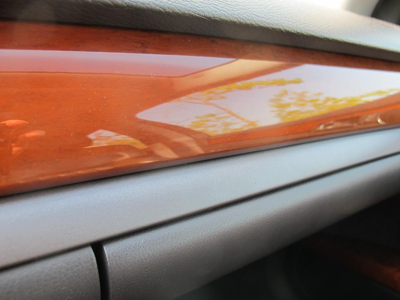 Crack in the dashboard wood trim veneer.