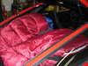 I bought a cheap sleeping bag to cover my cargo and also to use when I slept in the car. That was a good investment as it was very cold at night.