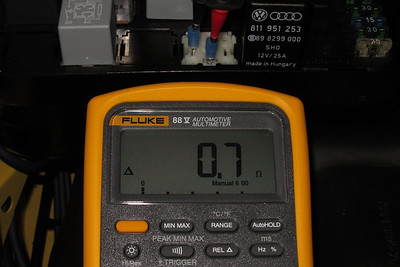 Resistance of the AC Condenser Fan Series Resistor which includes the wiring up to the relay socket.  An open circuit (OL dsplayed on the multimeter) indicates a failed resistor.
